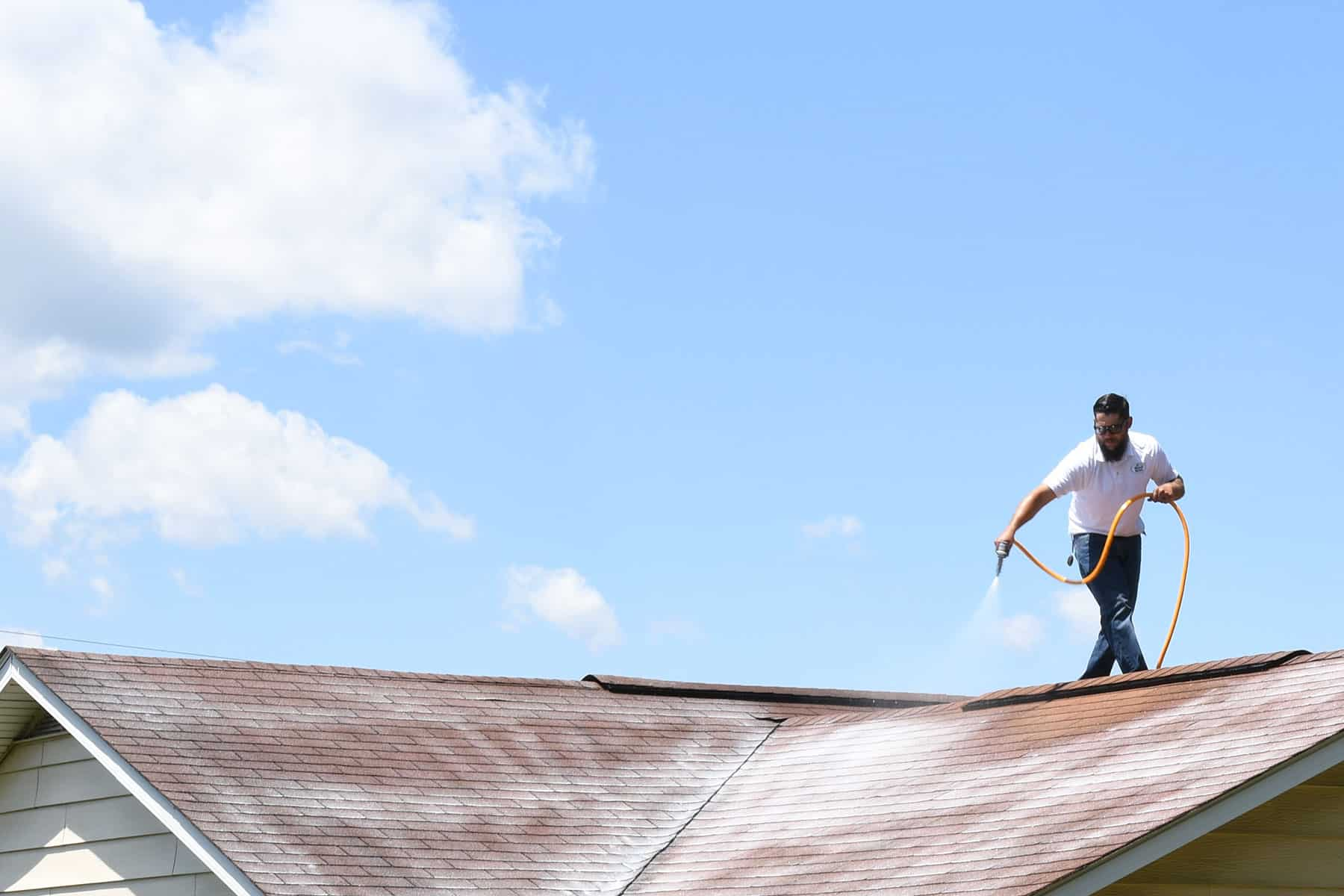 Tech working on a roof