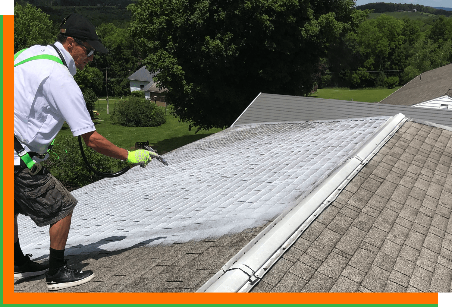Tech Spraying Roof Shingles with Treatment